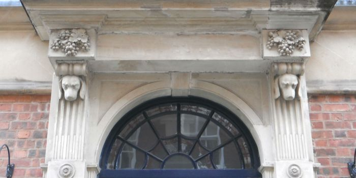 Talbot House doorway, with dogs-heads